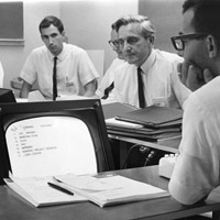photo of Doug in computer supported meeting 1967