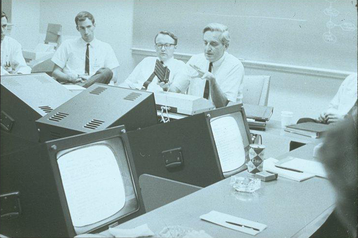 Doug Engelbart pictured in 1967 meeting using NLS to facilitate